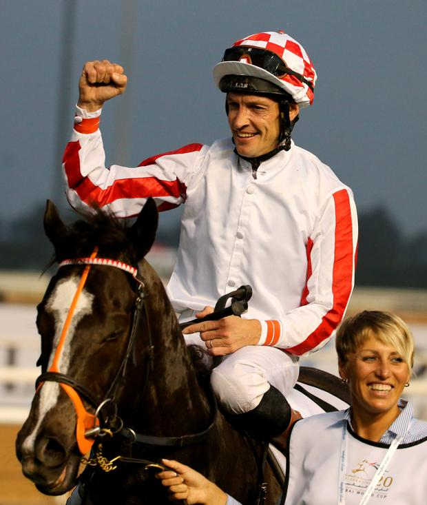 Richard Hughes celebrates Sole Power's victory in Dubai – the horse bids for his first win on Irish soil today