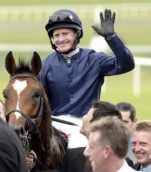 Mick Kinane waves to the crowd after winning the 2001 Irish Derby on board Galileo at The Curragh