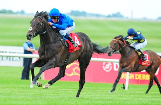 Jack Hobbs and William Buick on their way to winning the 150th Dubai Duty Free Irish Derby