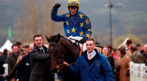 Jockey Ian Popham celebrates his victory onboard Annacotty in the Paddy Power Gold Cup Chase