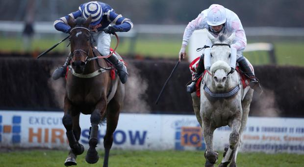 Charlie Poste riding Russe Blanc (right) clear the last to win The Betfred Classic Steeple Chase