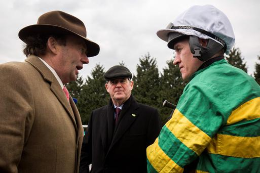 Nicky Henderson, JP McManus and Barry Geraghty before My Tent Or Yours worked at Kempton yesterday Photo: PA