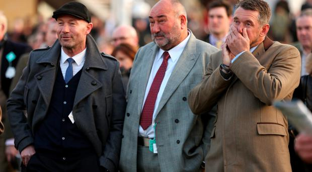 Lee Westwood (right), Alan Shearer and Chubby Chandler at Cheltenham yesterday (PA)