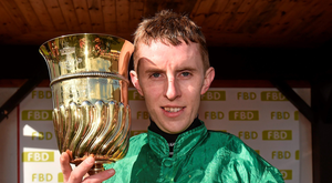 Jockey Mark Walsh lifts the La Touche Cup after victory in the FBD Cross Country Steeplechase Photo: Sportsfile