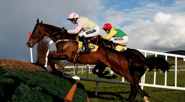 Douvan is poetry in motion under Ruby Walsh as he jumps alongside Sizing John on the way to landing the Ryanair Novice Chase at Punchestown Photo: Getty