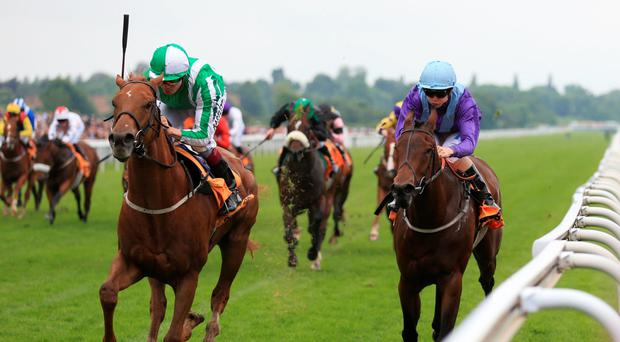Mr Lupton ridden by Jamie Spencer (left) wins The 888sport Charity Sprint, ahead of Dancing Star ridden by David Probert, at York. Photo: PA
