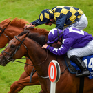Rattling Jewel, 14, with Wayne Lordan up, cross the line by a nose in a photo finish ahead of In Salutem, with Pat Smullen up, to win at the Curragh last night. Photo: Sportsfile
