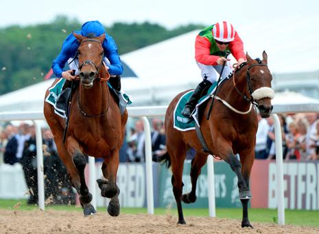 Antiquarium, ridden by James McDonald (left) beats Seamour to win the Northumberland Plate