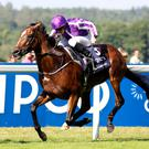 Highland Reel, ridden by Ryan Moore, goes on to win the King George VI And Queen Elizabeth Stakes at Ascothaving finished runner-up on. Photo: PA