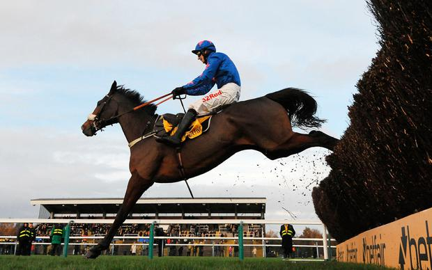 Cue Card, with Paddy Brennan up, will do battle with stablemate Thistlecrack at Kempton Picture: PA