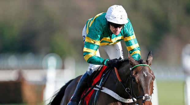 Barry Geraghty riding Buveur D'air clear the last to win The Betfred 'Follow Us On Twitter' Contenders Hurdle at Sandown Park. (Photo by Alan Crowhurst/Getty Images)