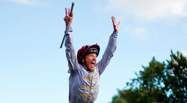Frankie Dettori celebrates in typical style after his victory aboard Al Jazi in the Oak Tree Stakes at Goodwood Photo: PA