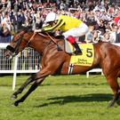 James Garfield and Frankie Dettori win The Dubai Duty Free Mill Reef Stakes at Newbury. Photo: PA