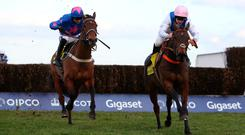 Waiting Patiently and Brian Hughes (right) lead Cue Card and Paddy Brennan away from the last fence before going on to win The Betfair Ascot Chase