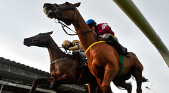 Bellshill, with Ruby Walsh up (left) races alongside Road To Respect (Sean Flanagan) on the way to winning Unibet Irish Gold Cup at Leopardstown. Photo by Ramsey Cardy/Sportsfile