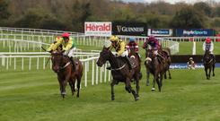 A year is a long time in racing: Paul Townend and Al Boum Photo (centre) about to take out Finian's Oscar (left) to allow The Storyteller (partially hidden) win the Champion Novice Chase at Punchestown last year. This bizarre climax didn't stop Willie Mullins taking the title