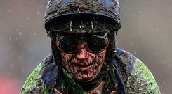 A mud-splattered Joe Fanning on Austrian School after running in the Chester Cup Handicap yesterday. Photo: PA
