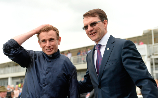 Trainer Aidan O'Brien (right) sent out four winners at Naas yesterday – three of which were ridden by stable jockey Ryan Moore. Photo: Sportsfile