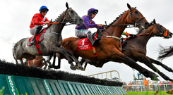 Lethal Steps and Davy Russell (left) negotiate the fifth flight on the way to winning the opener at Galway. Photo: Seb Daly/Sportsfile