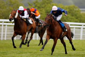 Pat Dobbs riding Czech It Out (R) win The Reheat Stakes at Goodwood racecourse on May 22, in Chichester (Alan Crowhurst/Getty Images)