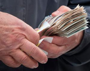 A bookmaker takes a bet at Cheltenham. Photo: Getty Images