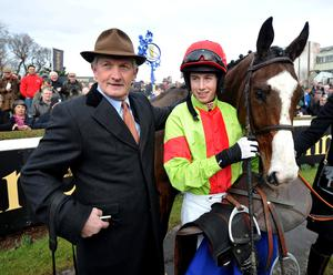 Jockey Bryan Cooper with trainer Dessie Hughes in the winners enclosure after Our Conor had won The Spring Juvenile Hurdle during the Hennessey Gold Cup Day at Leopardstown Racecourse, Dublin