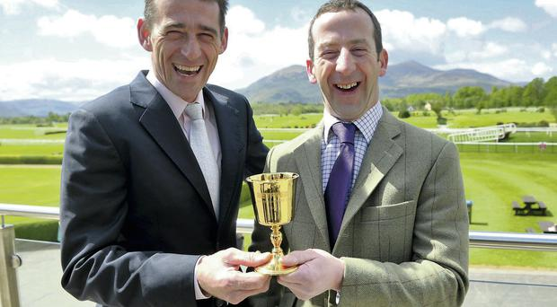 Jockey Davy Russell with four-time Cheltenham Gold Cup winner Jim Culloty, trainer of the horse Lord Windemere, at Killarney Racecourse, Co Kerry. Picture: DOMNICK WALSH