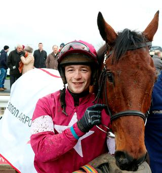 Outlander and David Mullins after winning the Grade 2 Shannon Airport Novice Chase at Limerick yesterday Photo:Alain Barr