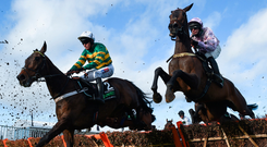 Sharjah and Patrick Mullins (R) keep a close eye on Buveur D'Air as they race past the stand during the Champion Hurdle yesterday David Fitzgerald/Sportsfile David Fitzgerald/Sportsfile