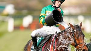 Rachael Blackmore cools down Minella Times after winning the Randox Grand National at Aintree on Saturday. Photo: Getty Images