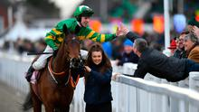 Mark Walsh celebrates with a punter after steering Aramax to victory in the Boodles Juvenile Handicap Hurdle. Photo: Dan Mullan/Getty