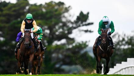 Jazzaway, with Conor McNamara up, right, on their way to winning the Guinness Handicap Hurdle alongside eventual second Western Victory, under Shane Fitzgerald at the Galway Races Summer Festival. Photo by David Fitzgerald/Sportsfile
