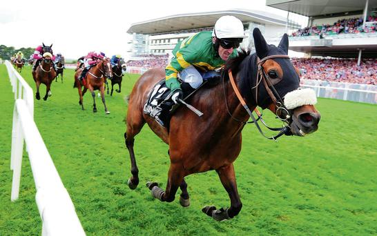 Tony McCoy drives Thomas Edison to victory in the Galway Hurdle
