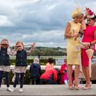 Elsa (4) and Isabella (5) Walsh daughters of Jockey Ruby Walsh enjoying day one of the Galway racing festival 2015. Also included on right are Corinna and Lorraine Hynes from Sligo