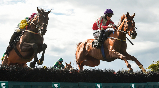 Top Othe Ra (right), with David Mullins up, sails over the final flight ahead of eventual third Stormey (Robert Dunne) on the way to winning the opener at Galway last night Photo: Sportsfile