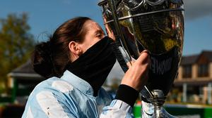 Rachael Blackmore celebrates with the cup after winning the Paddy Power Champion Hurdle on Honeysuckle at Punchestown. Photo: Harry Murphy/Sportsfile