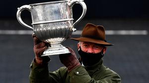 Willie Mullins celebrates with the cup after sending out Chacun Pour Soi to win the William Hill Champion Steeplechase during day one of the Punchestown Festival. Photo: David Fitzgerald/Sportsfile
