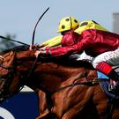 Postponed ridden by Andrea Atzeni (behind) beats Eagle Top ridden by Frankie Dettori in the King George VI And Queen Elizabeth Stakes.