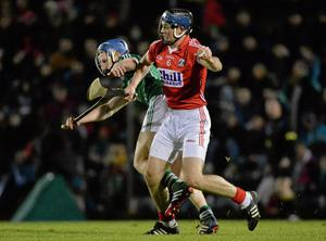 Cork's Christopher Joyce and Limerick's Conor Allis in action during last night's Division 1B clash in Páirc Uí Rinn