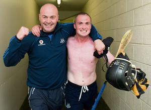 Dublin manager Anthony Daly and David O'Callaghan celebrate their win over the Cats