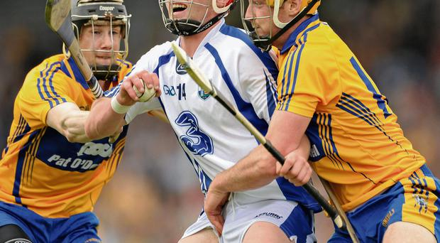 Waterford's Pauric Mahony comes under pressure from Patrick Donnellan (left) and Cian Dillon at Semple Stadium