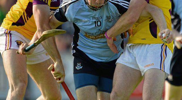Tomas Waters and Eoin Moore tackle Conor McCormack