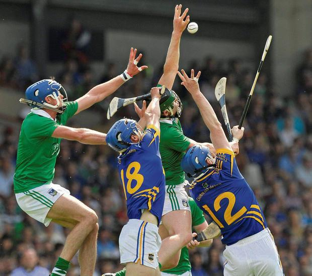 Limerick's Gavin O'Mahony and Stephen Walsh battle with Tipp duo Pa Bourke, 18, and John O'Brien