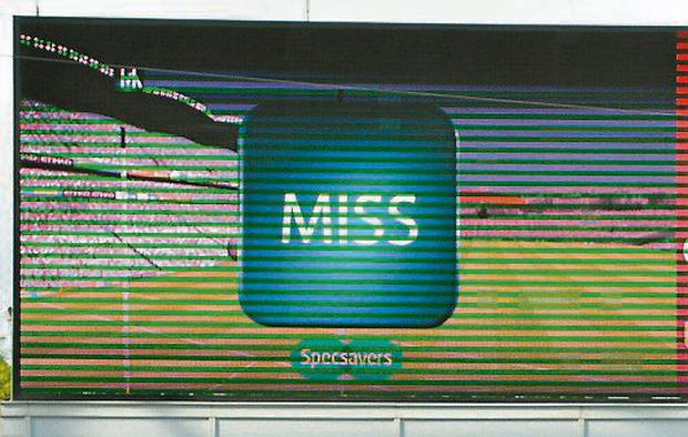 A 'miss' is displayed on the big screen following a decision made as a result of the Hawk-Eye Innovations Ltd cameras