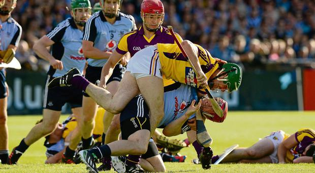 Dublin's David Treacy and Tomas Waters of Wexford become entangled during an incident early in their Leinster SHC quarter-final replay