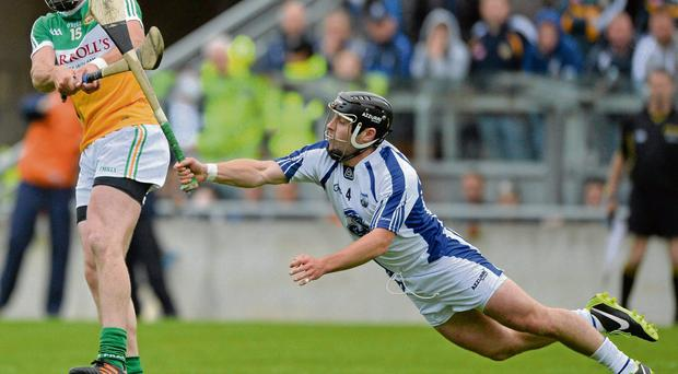 Waterford's Noel Connors dives to block Joe Bergin of Offaly during last night's qualifier.