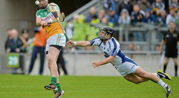 Waterford's Noel Connors tries to block Joe Bergin's shot at O'Connor Park