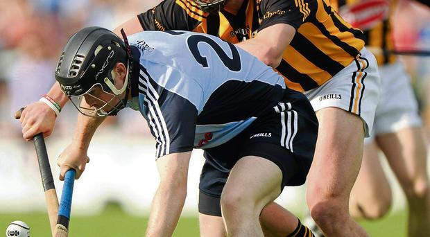 David O'Callaghan battles for the ball with Conor Fogarty in O'Moore Park.