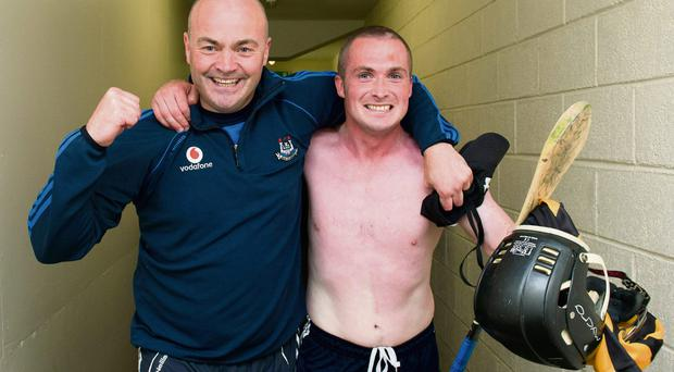 Dublin manager Anthony Daly and David O'Callaghan celebrate as they make their way to the dressing room. Photo: Sportsfile