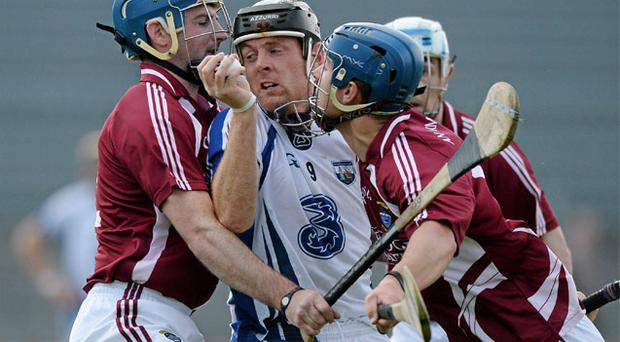 Waterford's Kevin Moran is the meat in the sandwich between Westmeath duo Robbie Greville (right) and Derek McNicholas